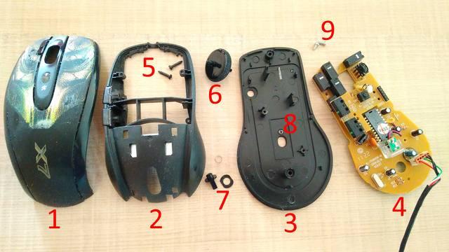 Полностью разобранная мышь. 1 - панцирь, 2 - скелет, 3 - подошва, 4 - основная плата, 5 -винты, скрепляющие основную конструкцию мыши, 6 - колесико, 7 - кнопка антивибрации, её подкладка и пружинка, 8 - пружинка под ларез (не потеряйте!), 9 - винты из основной платы